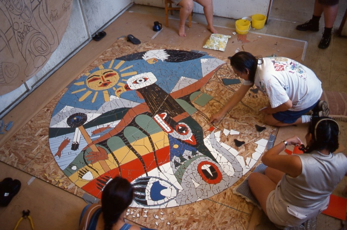 Artwork in Progress: Jerry Whitehead working with community members on a mosaic. photo by E. Rausenberg